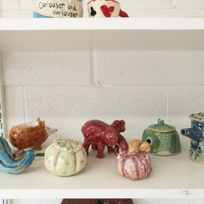 Various ceramic objects on a studio shelf